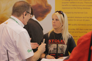 lady talking to a Crufts personnel